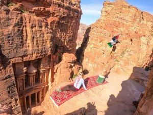 Photoshooting with the facade of the Al-Khazneh, a temple carved out of the rocks in Petra, Jordan