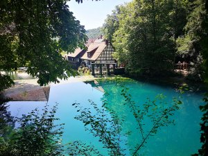 Blautopf with hammermill in Blaubeueren in the Swabian Alps in Southern Germany