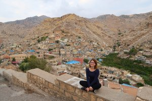 Sitting with a view of the ancient town and mountians of Aqrah, In Kurdistan, Iraq